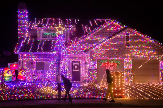 Tens of thousands of Christmas lights — 34,200 to be exact — cover the home of Shawn Long and Shauna Rosenthal on Tienda Drive near Mills Avenue in Lodi.