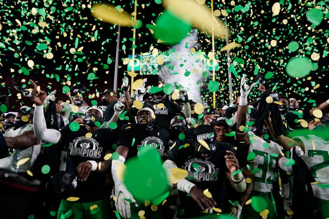 Oregon celebrates after winning the NCAA college football game for the Pac-12 Conference championship against Southern California Friday, Dec 18, 2020, in Los Angeles. Oregon won 31-24. (AP Photo/Ashley Landis)