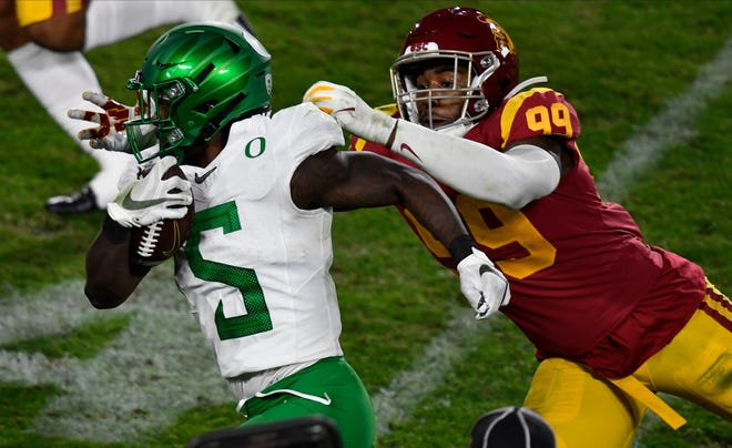 Oregon running back Sean Dollars (5) ran for 52 yards against linebacker Drake Jackson and USC during the Dec. 18 Pac-12 championship game. The Ducks won 31-24.