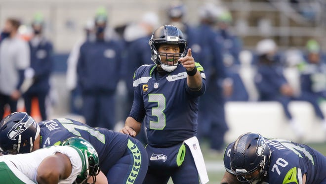 Quarterback Russell Wilson and the Seattle Seahawks can clinch a playoff berth with a win or tie at Washington on Sunday.