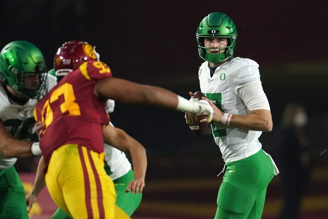 Dec 18, 2020; Los Angeles, California, USA; Oregon Ducks quarterback Tyler Shough (12) prepares to throw the ball in the first quarter against the Southern California Trojans during the Pac-12 Championship at United Airlines Field at Los Angeles Memorial Coliseum. Mandatory Credit: Kirby Lee-USA TODAY Sports
