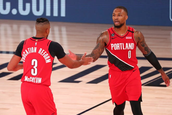 CJ McCollum (3), Damian Lillard and the Portland Trail Blazers open the season Wednesday when they host the Utah Jazz.