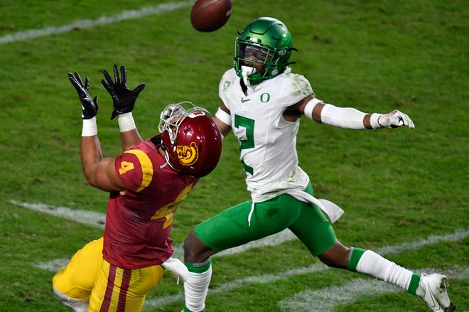 Oregon cornerback Mykael Wright (2) defends against USC's Bru McCoy during the Ducks' 31-24 Pac-12 championship game win over the Trojans on Dec. 18 in Los Angeles.