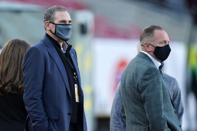 Pac-12 commissioner Larry Scott (left) and Oregon athletic director watch the Pac-12 championship football game between the Ducks and USC on Dec. 18, 2020, at the Los Angeles Memorial Coliseum.