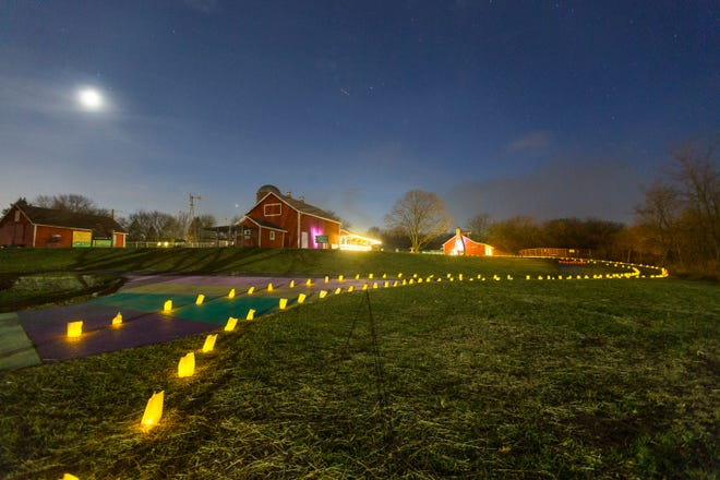 Thousands of lights illuminate the grounds at Lockwood Park on Friday, Dec. 18, 2020, in Rockford. The lighted pathway guided visitors through a covered bridge, the park's land and through a barn of farm animals.