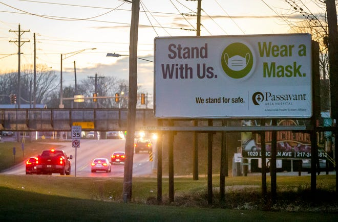 A billboard from Passavant Area Hospital on Morton Avenue in Jacksonville, Ill., encourages the public to wear a mask and is just one way that health-care providers are trying to remind the public to keep up the fight against the COVID-19 pandemic. [Justin L. Fowler/The State Journal-Register]