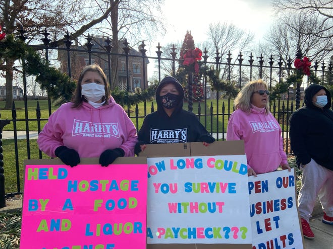 Bartender Deb Caffrey and manager Lindsay Beavers of Harry's Adult Daycare protest outside the Illinois Governor's Mansion Saturday.