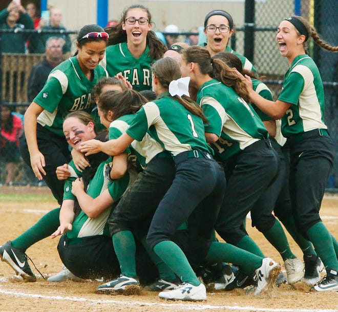 The GNB Voc-Tech Bears celebrate their Div. 2 State Softball Championship over Leicester High School.