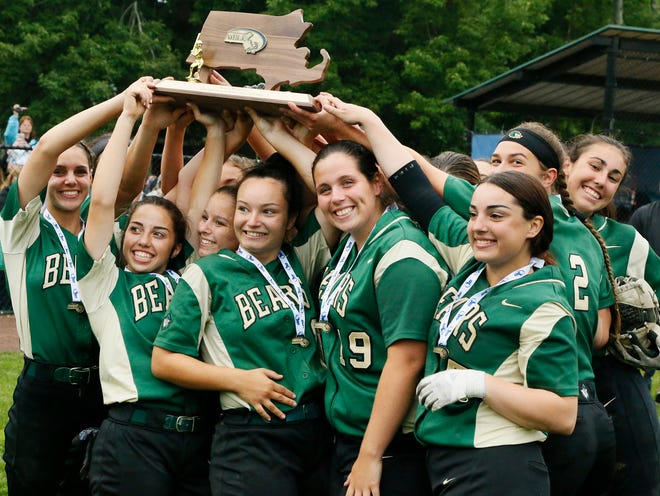 The Div. 2 State Championship Bears hold high the victors trophy.