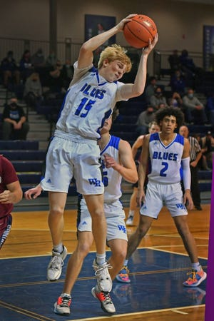 Washburn Rural's Jack Hutchinson grabs a rebound during Friday night's game against Seaman at Rural. After a scoreless first half, Hutchinson exploded for 24 points in the second half and overtime to lead the Junior Blues to a 62-57 overtime win.