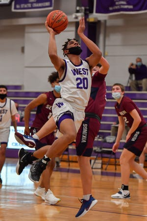 Trevion Alexander continued his big season with 30 points on 11-of-14 shooting in Friday night's 71-52 win over Manhattan. He also locked up Manhattan star Owen Braxmeyer defensively.
