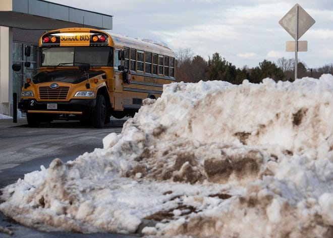 A bus waits for students outside an elementary school in Worcester.