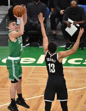 Celtics guard Payton Pritchard shoots the ball over Nets guard Landry Shamet during the second half Friday night at TD Garden.