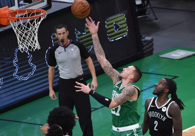 Celtics center Daniel Theis (27) gets fouled by Nets forward Taurean Prince (2) during the first half at TD Garden.