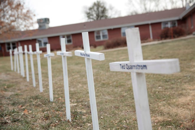 White crosses on the lawn of Good Samaritan Society nursing home Dec. 8 in Canton, S.D., commemorate residents who have died in recent weeks of the coronavirus.
