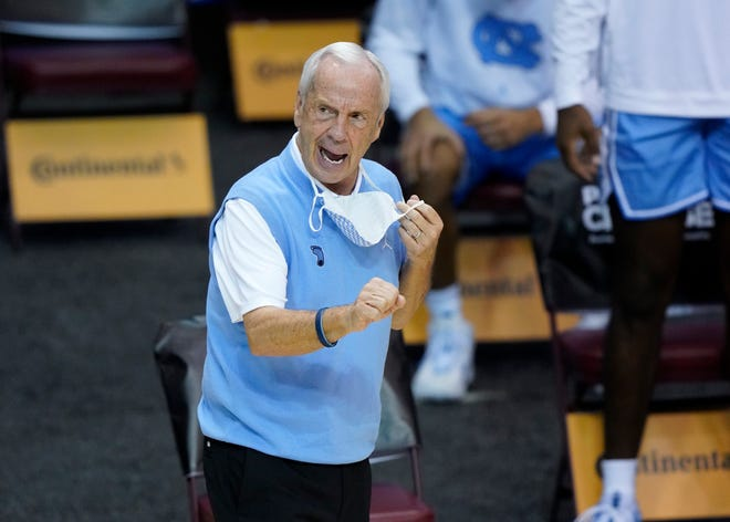 Coach Roy Williams directs his North Carolina team during a victory against UNLV in the relocated Maui Invitational.