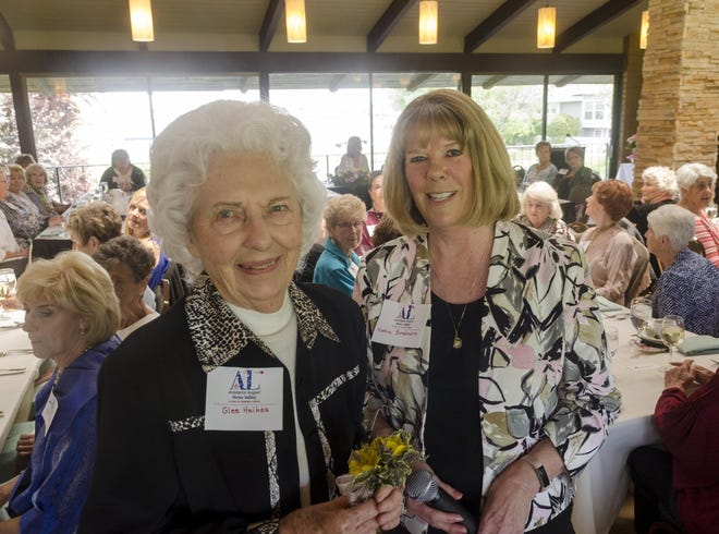 Katie Bordonaro, right, presents Glee Heikes a corsage as the Assistance League of Victor Valley celebrated its 35th anniversary during a luncheon at Spring Valley Lake Country Club in Victorville on May 15, 2017.