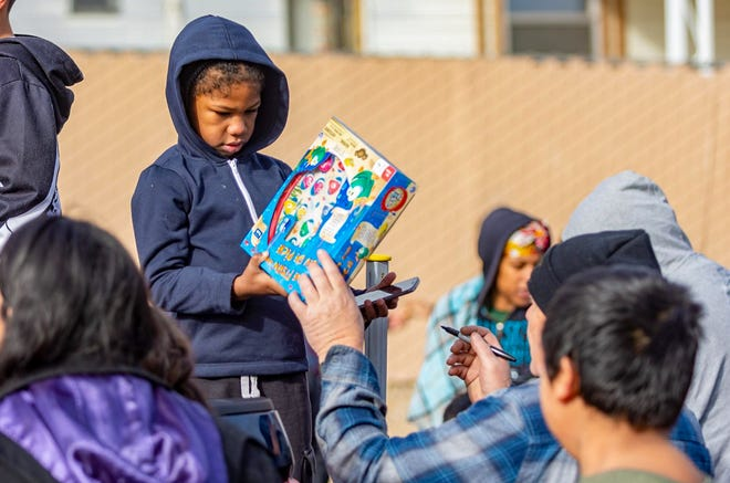 Delontae Fowler makes his toy selection during the 24th annual Christmas Cops and Kids toy drive on Dec. 24, 2019. The Barstow Police Department's Police Activities League announced the event would be postponed in 2020 due to  COVID-19 restrictions.