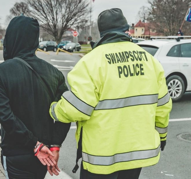 A photo of the arrest of Haverhill resident Ernst Jean-Jacques.