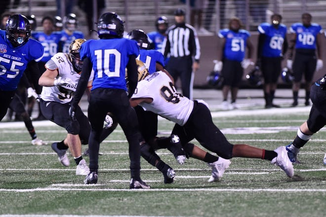 Abilene High's Tavarus Mitchell (80) brings down North Crowley's DeJuan Lacy (24) for a loss during Friday's Region I-6A Division II area playoff game at Tarleton Memorial Stadium in Stephenville on Dec. 18, 2020. The Eagles won 12-7 to advance to the region semifinal on Dec. 26 at Globe Life Park.