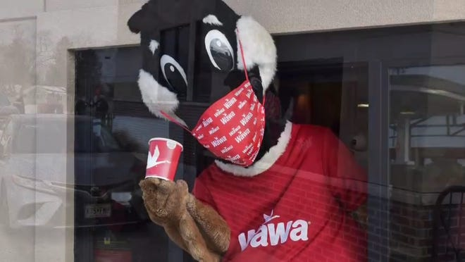 Wawa opens its first store with a drive-thru window, offering coffee, hoagies  and other items on breakfast, lunch and dinner menus.