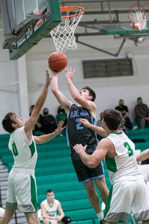 Adena's Nate Throckmorton takes it to the rim Friday night at Huntington High School. The Warriors defeated the Huntsmen 75-42.