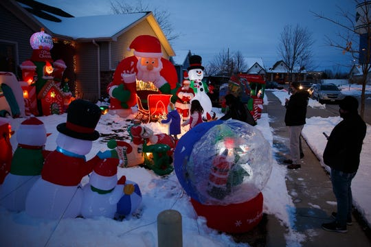 Dave Greulich, 68 of Ames, Iowa, visits with kids at his front yard Santa show on Nov. 28, 2020. He asks for canned food donations, which he then donates to the food pantry, 2 tons total in the seven years he has set up shop outside his Ames home.
