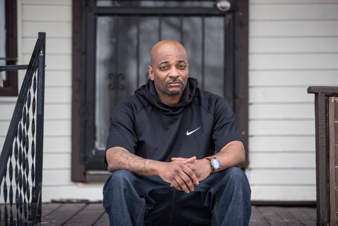 Bernard Howard, 44, poses for a photo on the east side of Detroit, Friday, Dec. 18, 2020.