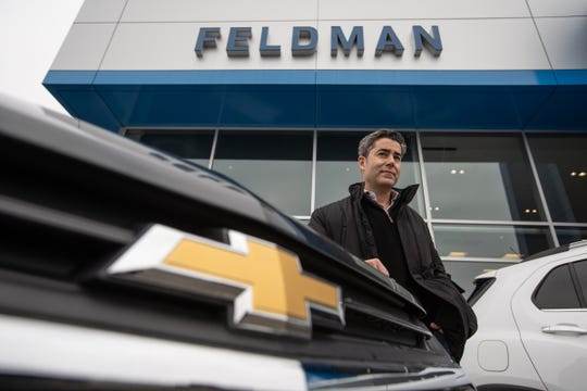 Feldman Chevrolet of Livonia owner Jay Feldman stands outside of the dealership in Livonia on December 18, 2020. Feldman swooped in to save what was Tennyson Chevrolet in Livonia in 2009 and sentenced to death by General Motors.