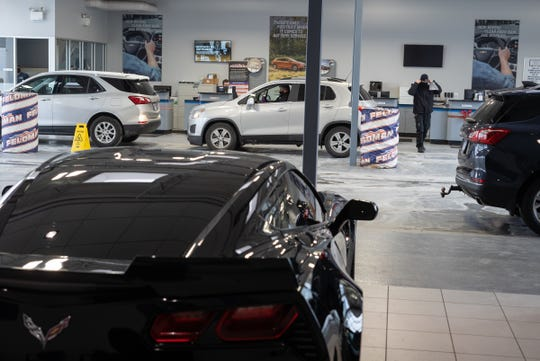Workers move around in the Certified Service and Collision Center at Feldman Chevrolet of Livonia on December 18, 2020.