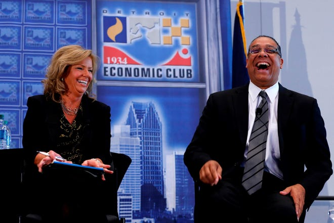 Benny Napoleon shares a lighter moment with Free Pess Columnist Carol Cain during the Detroit Economic Club's Mayoral Debate in 2013.
