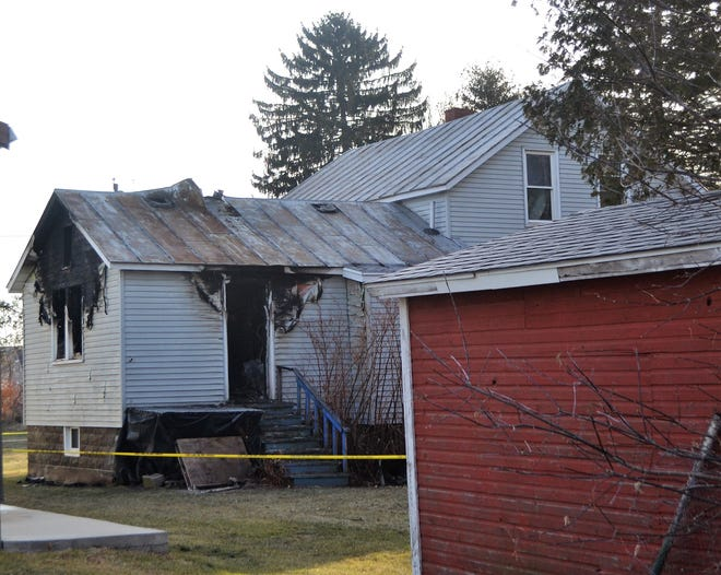 Damage from a fire Thursday afternoon can be seen from the rear of the home at 225 Michigan Street in Oconto.