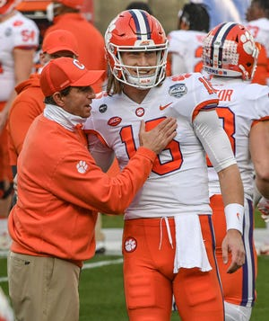 Clemson quarterback Trevor Lawrence with coach Dabo Swinney before the ACC championship game against Notre Dame.