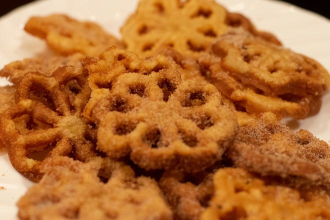 Rosettes, a crispy cookie deep-fried and then covered with powdered sugar or a sugar-cinnamon mixture.