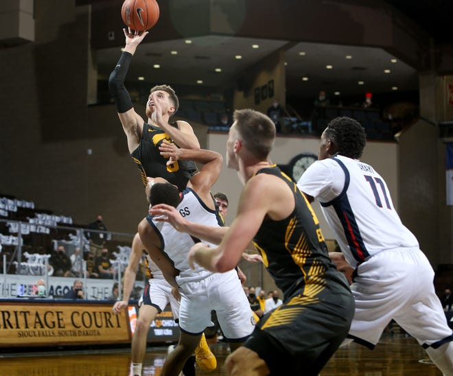 SIOUX FALLS, SD - DECEMBER 19: Jordan Bohannon #3 of the Iowa Hawkeyes lays the ball up over Jalen Suggs #1 of the Gonzaga Bulldogs during their game at the Sanford Pentagon on December 17, 2020 in Sioux Falls, South Dakota. (Photo by Dave Eggen/Inertia)