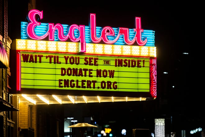 Light bulbs cycle on the Englert Theatre marquee during an event, Friday, Dec. 18, 2020, at 221 E Washington Street in downtown Iowa City, Iowa.