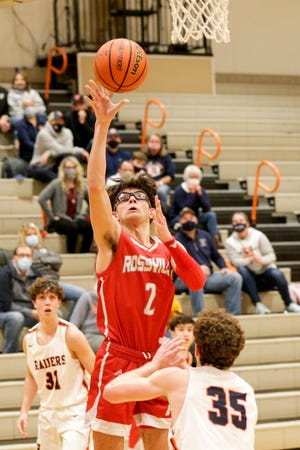 Rossville's Damon Shaw (2) goes up for a shot above Harrison's Bryant Smith (35) during the fourth quarter of an IHSAA boys basketball game, Friday, Dec. 18, 2020 in West Lafayette.