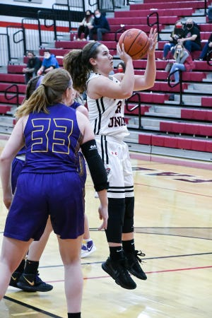 Fairfield Union senior Marisa Malone shoots the ball Friday night at FUHS. The Falcons defeated the visiting Bulldogs 36-30 to improve to 3-0 on the season.