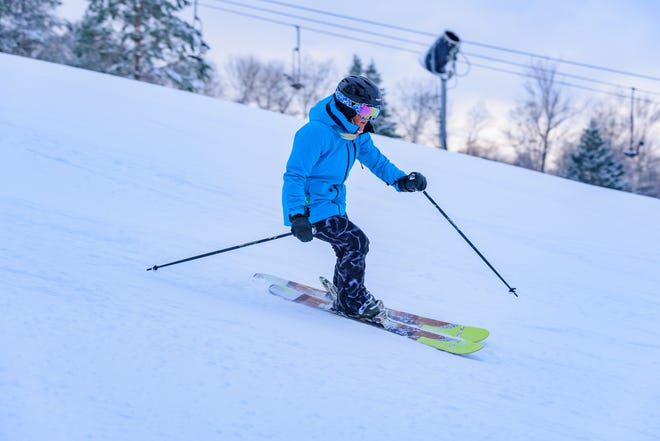 A skier hits the slopes on opening day at Snow Trails in Mansfield.