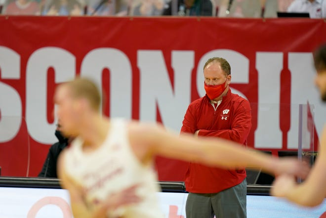 Wisconsin head coach Greg Gard watches from the sideline as his team takes on Louisville at the Kohl Center.