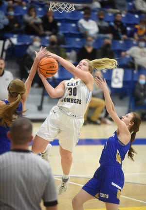 Mountain Home's Addison Yates attacks the basket during a recent game against Harrison. The Lady Bombers fell at West Plains, Mo., Saturday.