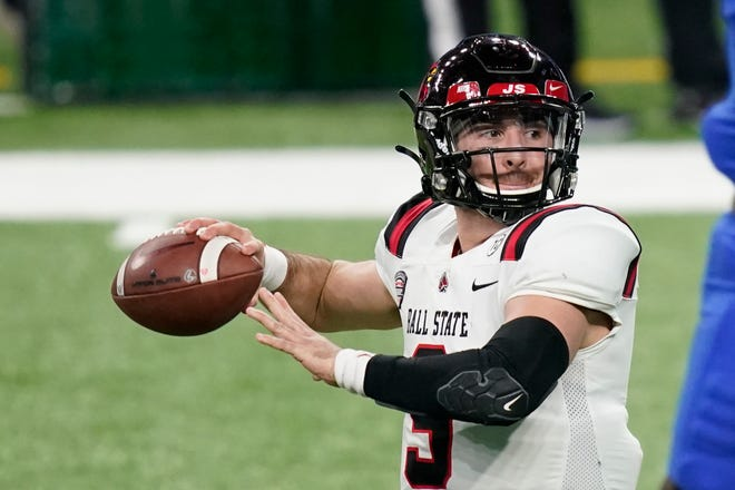Ball State quarterback Drew Plitt throws during the first half of the Mid-American Conference championship NCAA college football game against Buffalo, Friday, Dec. 18, 2020 in Detroit. (AP Photo/Carlos Osorio)