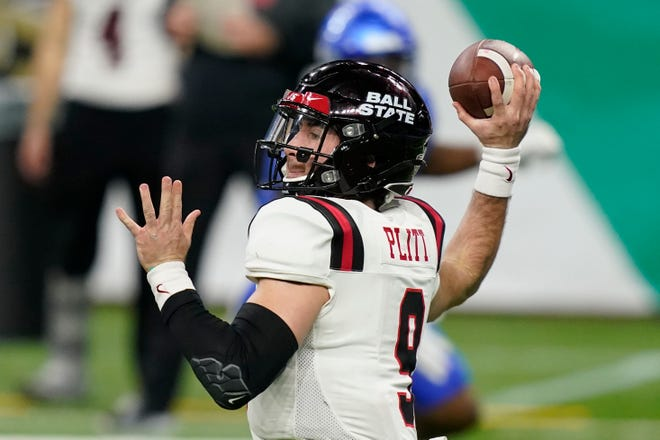 Ball State quarterback Drew Plitt throws during the second half of the Mid-American Conference championship NCAA college football game against Buffalo, Friday, Dec. 18, 2020 in Detroit. (AP Photo/Carlos Osorio)