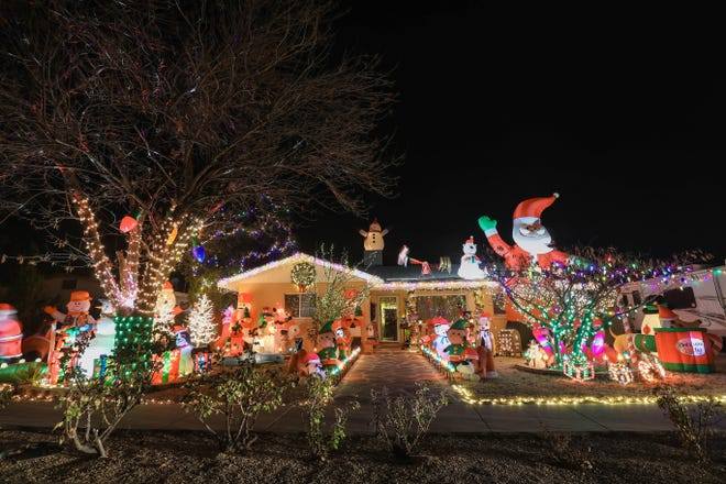 The home of Felix Cordero at 2210 Turrentine Dr. in Las Cruces is covered in Christmas lights and blow-up santas on Friday, Dec. 18, 2020.