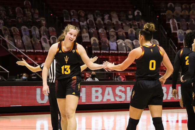ASU's Maggie Besselink (13) and Taya Hanson (0) during win at Utah on Friday. The Sun Devils are at Colorado on Sunday.