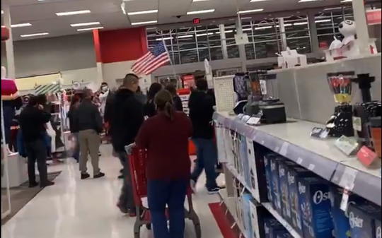 Anti-mask protestors march throughout a Phoenix Target store on Dec. 17, 2020.
