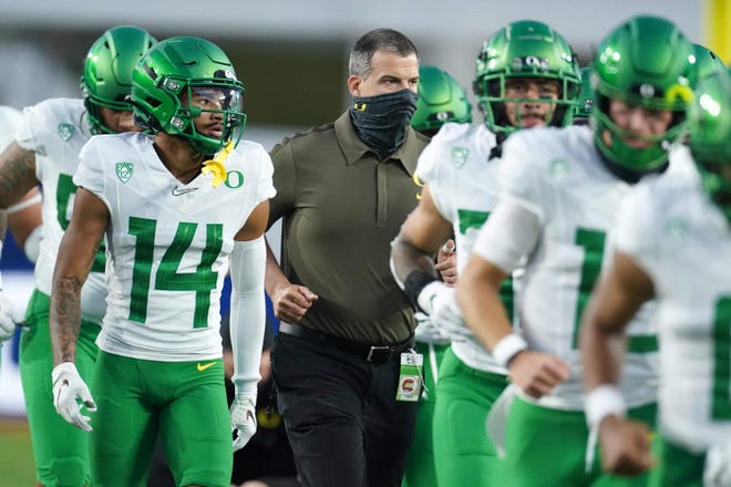 Dec 18, 2020; Los Angeles, California, USA; Oregon Ducks head coach Mario Cristobal takes the field before the Pac-12 Championship against the Southern California Trojans at United Airlines Field at Los Angeles Memorial Coliseum. Mandatory Credit: Kirby Lee-USA TODAY Sports