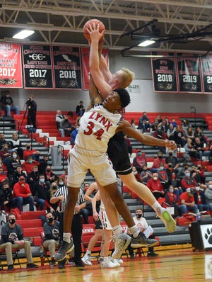 Brandon Valley's Jackson Hilton attempts to stop Yankton's Matthew Mors on his way to the basket on Friday, December 18, at Brandon Valley High School.