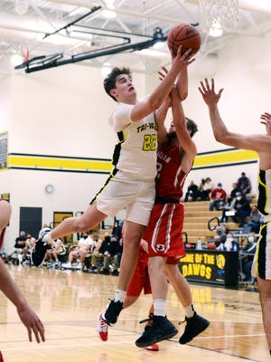 Erik Neal pulls down a rebound over Sheridan's Landen Russell in Tri-Valley's 58-49 win on Friday night in Dresden.