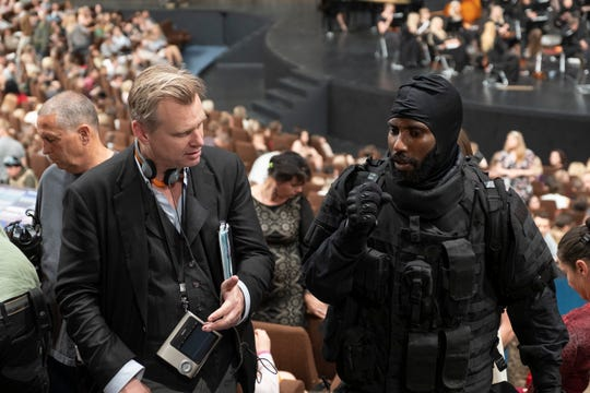"""Christopher Nolan and John David Washington prepare for the """"Tenet"""" opening scene shot in an Estonian concert hall with thousands of extras."""